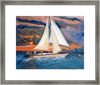 Sunset And Yacht Framed Print by Kostas Koutsoukanidis