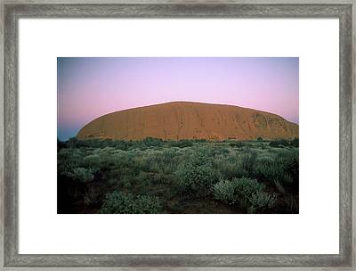 Sunset At Ayre's Rock Framed Print by Gary Wonning