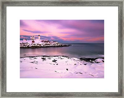 Sunset At Nubble Lighthouse In Maine In Winter Snow Framed Print