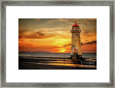Sunset At The Lighthouse Framed Print by Adrian Evans