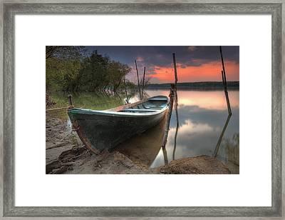 Sunset Boat Framed Print by Evgeni Dinev