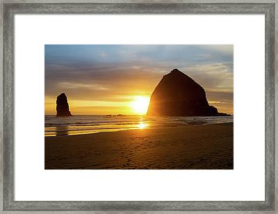 Sunset By Haystack Rock At Cannon Beach Framed Print by David Gn