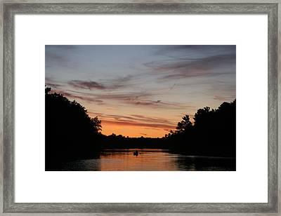 Sunset Canoe Framed Print by Ty Helbach