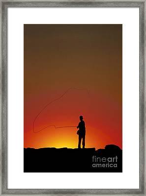 Sunset Casting Framed Print by John Greim