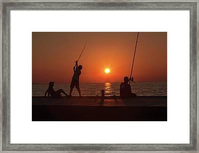 Sunset Fishermenr Framed Print