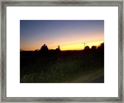 Sunset Haze Framed Print by Laurie Kidd