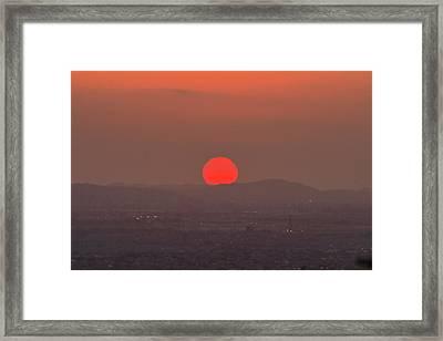 Sunset In Smog Framed Print