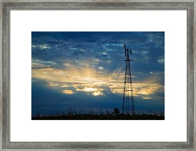 Sunset Light Through Heavy Clouds Framed Print