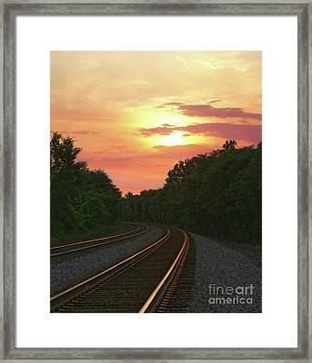 Sunset Lighting Up The Rails Framed Print by Benanne Stiens