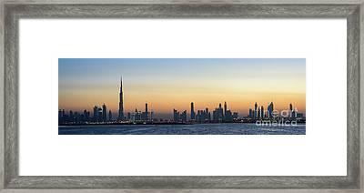Sunset On Dubai Skyline Framed Print by David GABIS