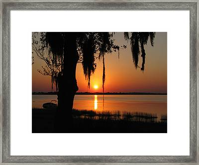 Sunset On Lake Minneola Framed Print by Peg Urban