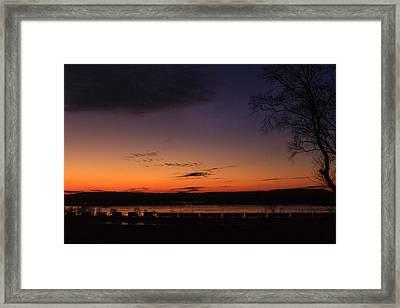 Sunset On The River Framed Print by Joni Eskridge