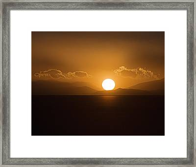 Framed Print featuring the photograph Sunset On The Salar by Ron Dubin