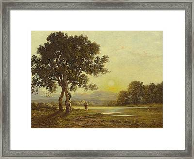 Sunset Over A Landscape With Trees Framed Print