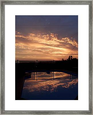 Sunset Over A Pool Framed Print by Edan Chapman