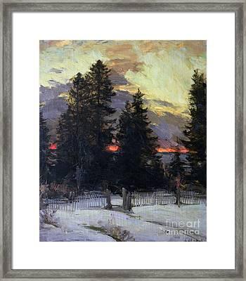 Sunset Over A Winter Landscape Framed Print