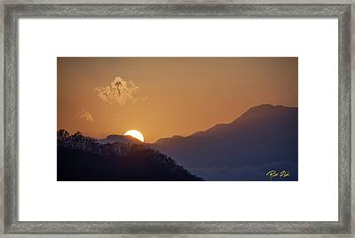 Framed Print featuring the photograph Sunset Over Asia  by Rikk Flohr