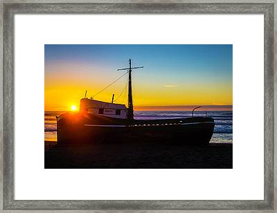 Sunset Over Beached Boat Framed Print by Garry Gay
