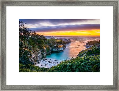 Sunset Over China Cove Framed Print by David Gilliland