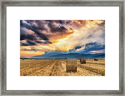 Sunset Over Farm Field With Hay Bales Framed Print