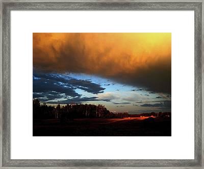 Sunset Over Hayfield Framed Print