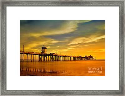 Sunset Over Huntington Beach Pier Framed Print by Peter Dang