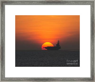 Sunset Over The Aircraft Carrier  Framed Print by Celestial Images