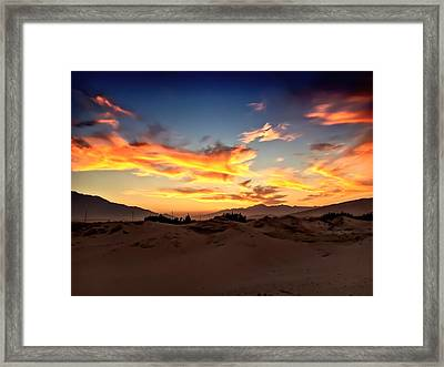 Sunset Over The Desert Framed Print by Chris Tarpening