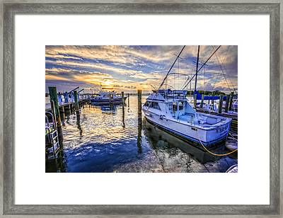 Sunset Over The Docks Framed Print by Debra and Dave Vanderlaan