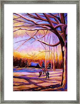 Sunset Over The Hockey Game Framed Print by Carole Spandau