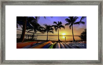 Sunset Over The Kayaks Framed Print