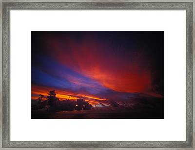 Sunset Over The Ocean Framed Print by Nick Norman