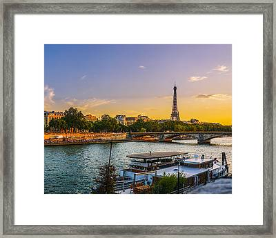 Sunset Over The Seine In Paris Framed Print