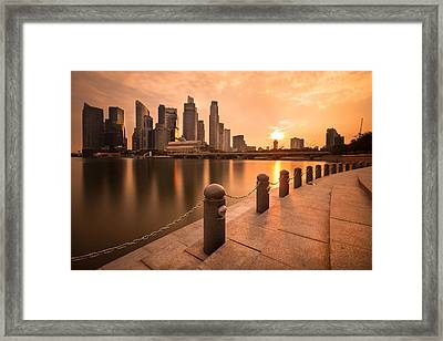 Sunset Over The Singapore Skyline Framed Print by Hak87