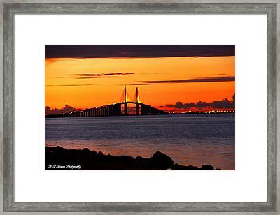 Sunset Over The Skyway Bridge Framed Print