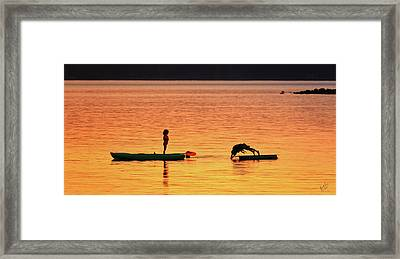 Sunset Play Framed Print by Rick Lawler