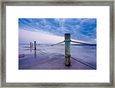 Sunset Reef Pilings Framed Print by Adam Pender