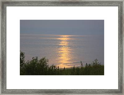 Sunset Reflections Framed Print by Chuck Bailey