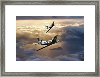Sunset Sabres Framed Print by Peter Chilelli