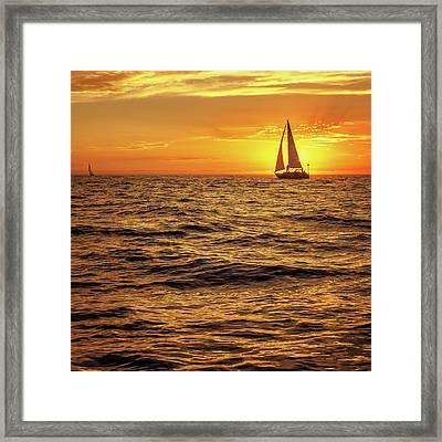 Sunset Sailing Framed Print by Steve Spiliotopoulos
