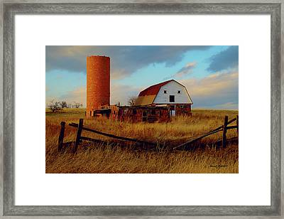 Framed Print featuring the photograph Sunset Silo Barn by Stephen  Johnson