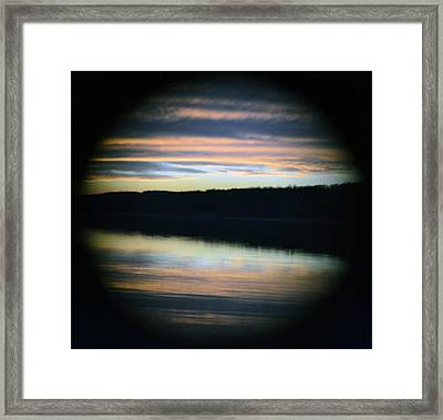 Sunset Through A Hole Framed Print by Michael Fitzpatrick