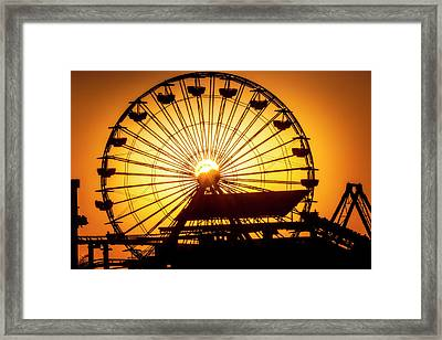 Sunset Through Ferris Wheel Framed Print