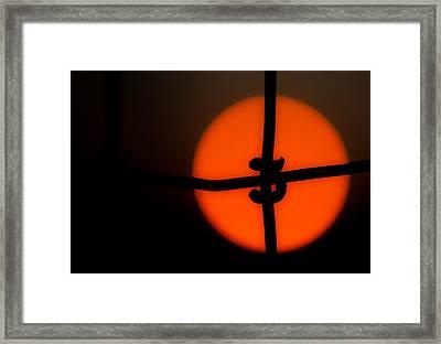 Sunset Through The Fence Framed Print by Mark Alder