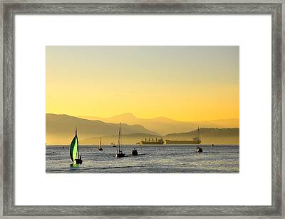 Sunset With Green Sailboat Framed Print