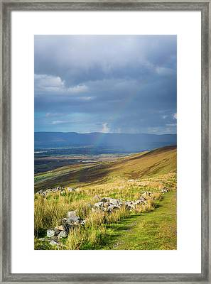 Framed Print featuring the photograph Sunshine And Raining Down With Rainbow On The Countryside In Ire by Semmick Photo