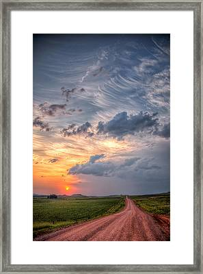 Sunshine And Storm Clouds Framed Print