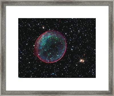 Framed Print featuring the pyrography Supernova Bubble Resembles Holiday Ornament by Artistic Panda