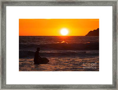 Surfer At Sunset  Framed Print by Amanda Elwell