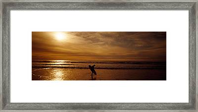 Surfer Ocean Beach Carmel Ca Framed Print by Panoramic Images